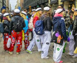 Finnish students wearing their overalls and hats during Vappu